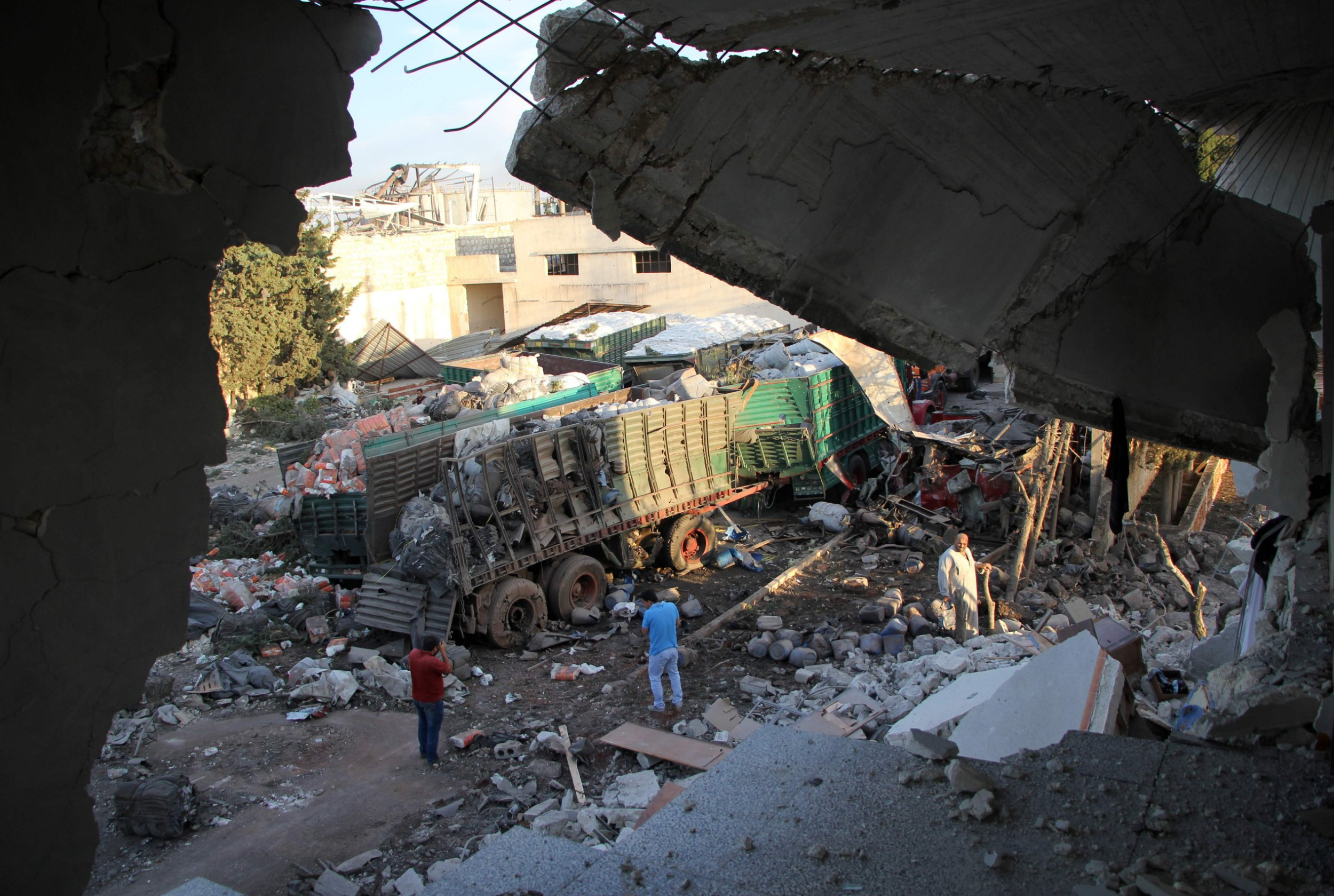 Aid is seen strewn across the floor in the town of Orum al-Kubra on the western outskirts of the northern Syrian city of Aleppo on September 20, 2016, the morning after a convoy delivering aid was hit by a deadly air strike. The UN said at least 18 trucks in the 31-vehicle convoy were destroyed en route to deliver humanitarian assistance to the hard-to-reach town. / AFP PHOTO / Omar haj kadourOMAR HAJ KADOUR/AFP/Getty Images