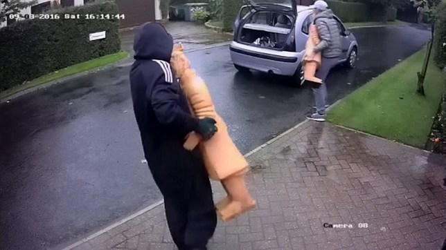 This shocking footage shows the moment two brazen thieves helped themselves to a pair of terracotta warriors worth £2,000 in broad daylight. See Ross Parry story RPYSTATUE; CCTV footage shows the pair pull up outside a house in a Citroen C3 before pilling out the car and opening the boot. The men are seen to head to different ends of the driveway and are next seen carrying up the two statues, worth £1,000 each back towards the car. One of two three-foot high statues is then bundled into the boot off the car, with the other heaved onto the back passenger seat before the thieves climb in and are driven off by a third man.