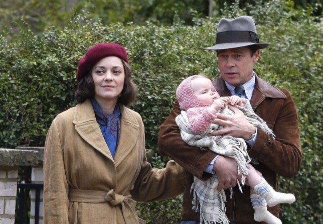 Mandatory Credit: Photo by Beretta/Sims/REX/Shutterstock (5622106ck) Marion Cotillard and Brad Pitt with a baby 'Five Seconds of Silence' on set filming, London, Britain - 31 Mar 2016