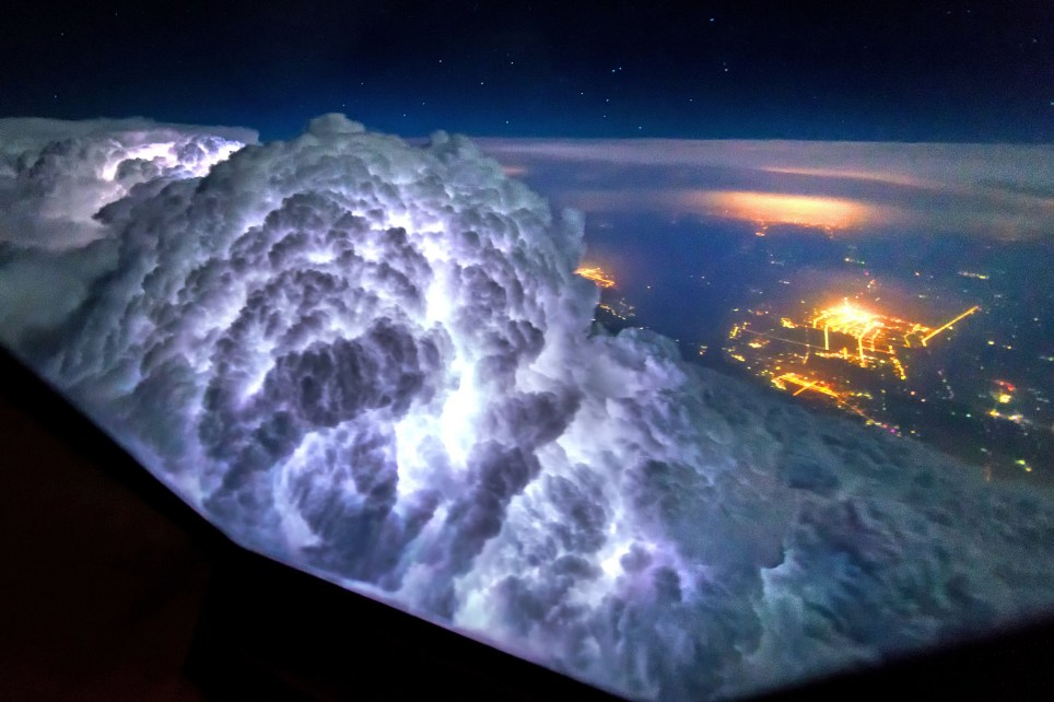 PIC BY CHRISTANN VAN HEIJST AND DAANS KRANS/CATERS NEWS - (PICTURED: Thunderstorms light up the insides of clouds.) - This is truly heavenly weather as pictures taken from an airplane cockpit reveal what pilots see from above. It looks like at cruising altitude the weather really hots up, with the flight deck revealing some amazing scenes. Thunderstorms light up the insides of clouds, lightening streaks across the sky like cracks in a windscreen, the northern lights sweep uninterrupted across the sky and the galaxy stretches on forever. The pictures were captured by senior first officer Christiaan van Heijst, a 33-year-old from the Netherlands, and his friend Daan Krans. SEE CATERS COPY.