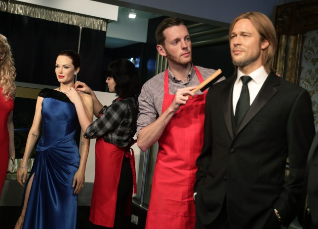 Studio assistants Alex Cameron and Olivia Steen move apart the wax figures of Brad Pitt and Angelina Jolie at Madame Tussauds London following the news of their divorce. PRESS ASSOCIATION Photo. Picture date: Wednesday September 21, 2016. The Hollywood couple, known collectively as Brangelina, married in 2014 after 10 years together. See PA story SHOWBIZ Jolie. Photo credit should read: Yui Mok/PA Wire