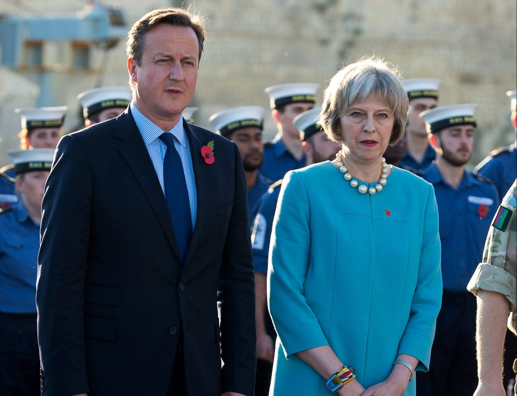 VALLETTA, MALTA - NOVEMBER 11: (L-R) British Prime Minister David Cameron and Home Secretary Theresa May attend a remembrance service on HMS Bulwark during the Valletta Summit on migration on November 11, 2015 in Valletta, Malta. The Summit will bring together representatives from the European Union and African countries to address the challenges and opportunities of the largest migration of people to Europe since World War II. (Photo by Ben Pruchnie/Getty Images)