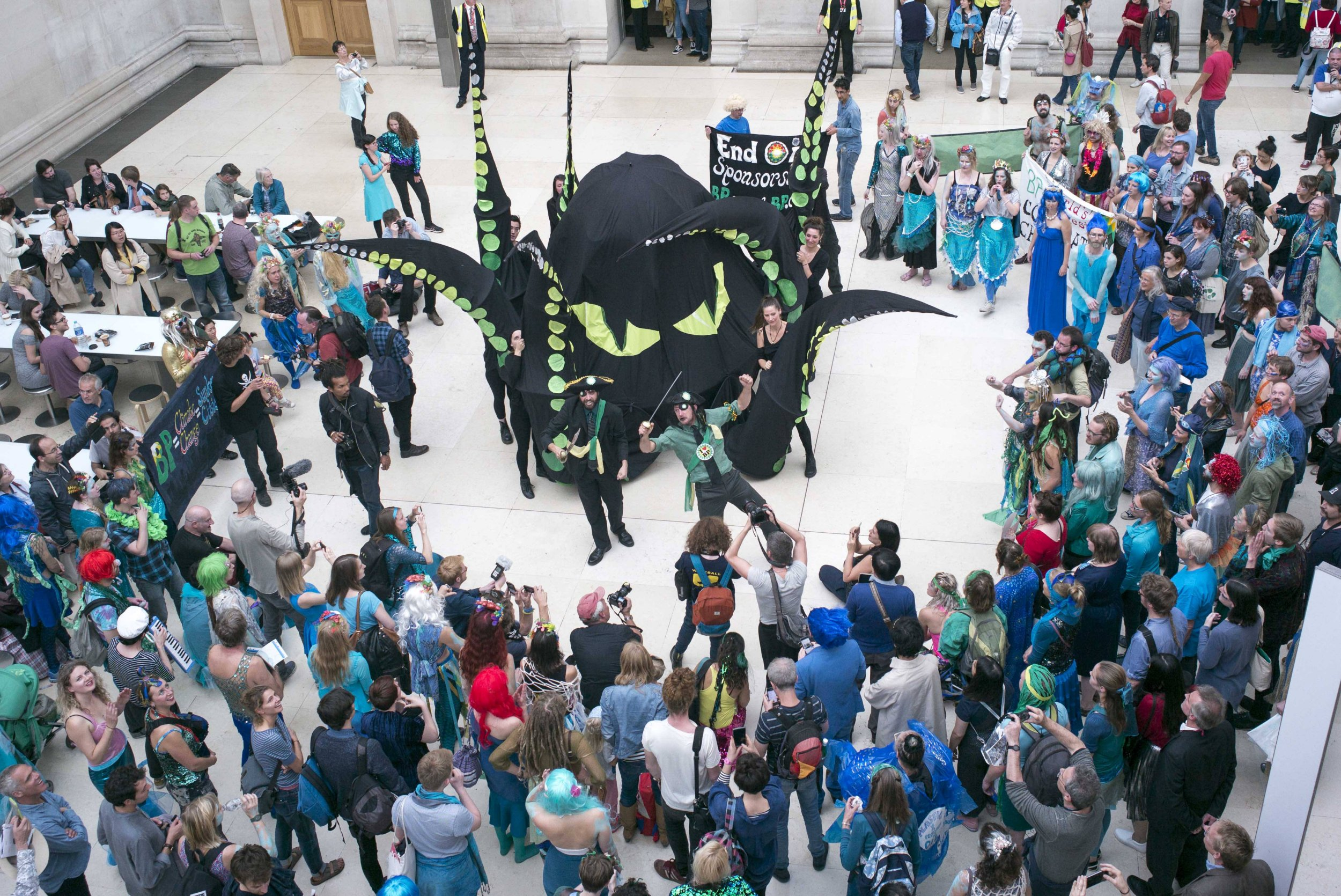 A 'splashmob' protest lead by theatrical protest group BP or not BP? inside the British Museum, central London, in response to BPís controversial sponsorship of the museumís current ëSunken Citiesí exhibition. PRESS ASSOCIATION Photo. Picture date: Sunday September 25, 2016. See PA story PROTEST BP. Photo credit should read: Rick Findler/PA Wire