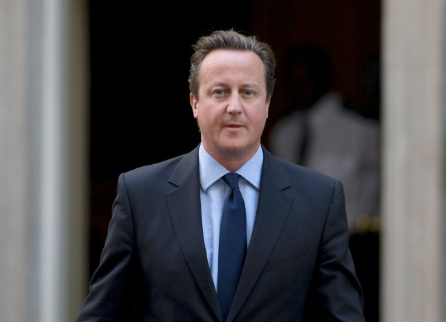 Britain's Prime Minister David Cameron leaves 10 Downing Street for the House of Commons for the weekly session of Prime Minister's Question Time in London, Wednesday, Sept. 11, 2013. (AP Photo/Alastair Grant)