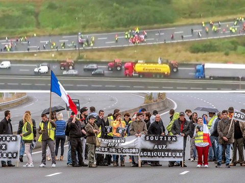 Farmers join massive blockade at Channel Tunnel in protest at Calais Jungle