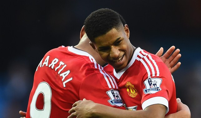 MANCHESTER, ENGLAND - MARCH 20: Winning goalscorer Marcus Rashford of Manchester United (R) and team mate Anthony Martial celebrate victory after the Barclays Premier League match between Manchester City and Manchester United at Etihad Stadium on March 20, 2016 in Manchester, United Kingdom. (Photo by Laurence Griffiths/Getty Images)