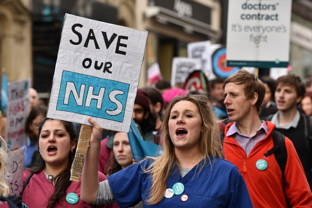 BRISTOL, ENGLAND - APRIL 26: Junior doctors and supporters rally through the city centre during an all-out strike on April 26, 2016 in Bristol, England. Junior doctors across England have begun a two day strike in an ongoing dispute with the Government over the forced introduction of new contracts. The BMA backed industrial action includes a walk-out on emergency care for the first time in NHS history. (Photo by Rufus Cox/Getty Images)
