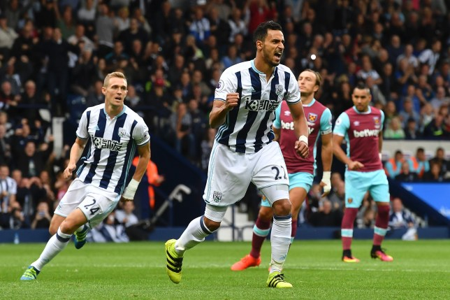West Bromwich Albion's Belgian midfielder Nacer Chadli (C) scoring a penalty for the opening goal during the English Premier League football match between West Bromwich Albion and West Ham United at The Hawthorns stadium in West Bromwich, central England, on September 17, 2016. / AFP / Ben STANSALL / RESTRICTED TO EDITORIAL USE. No use with unauthorized audio, video, data, fixture lists, club/league logos or 'live' services. Online in-match use limited to 75 images, no video emulation. No use in betting, games or single club/league/player publications. / (Photo credit should read BEN STANSALL/AFP/Getty Images)