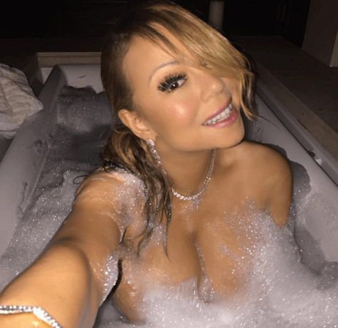 Mariah Carey risks exposing her breasts as she shares titillating new music news