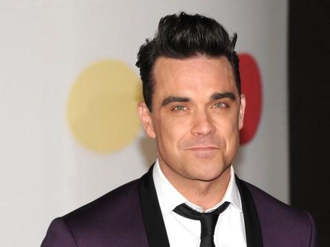 Robbie Williams announces comeback with a brand new album