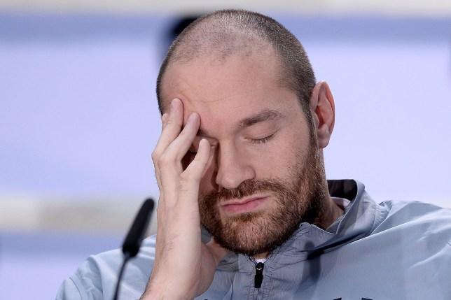 COLOGNE, GERMANY - APRIL 28: Tyson Fury reacts as Wladimir Klitschko speaks to the media during Tyson Fury and Wladimir Klitschko head to head press conference on April 28, 2016 in Cologne, Germany. Fury v Klitschko Part 2 will take place in Manchester on July 9 for the WBO, WBA and IBO heavyweight belts. (Photo by Sascha Steinbach/Bongarts/Getty Images)