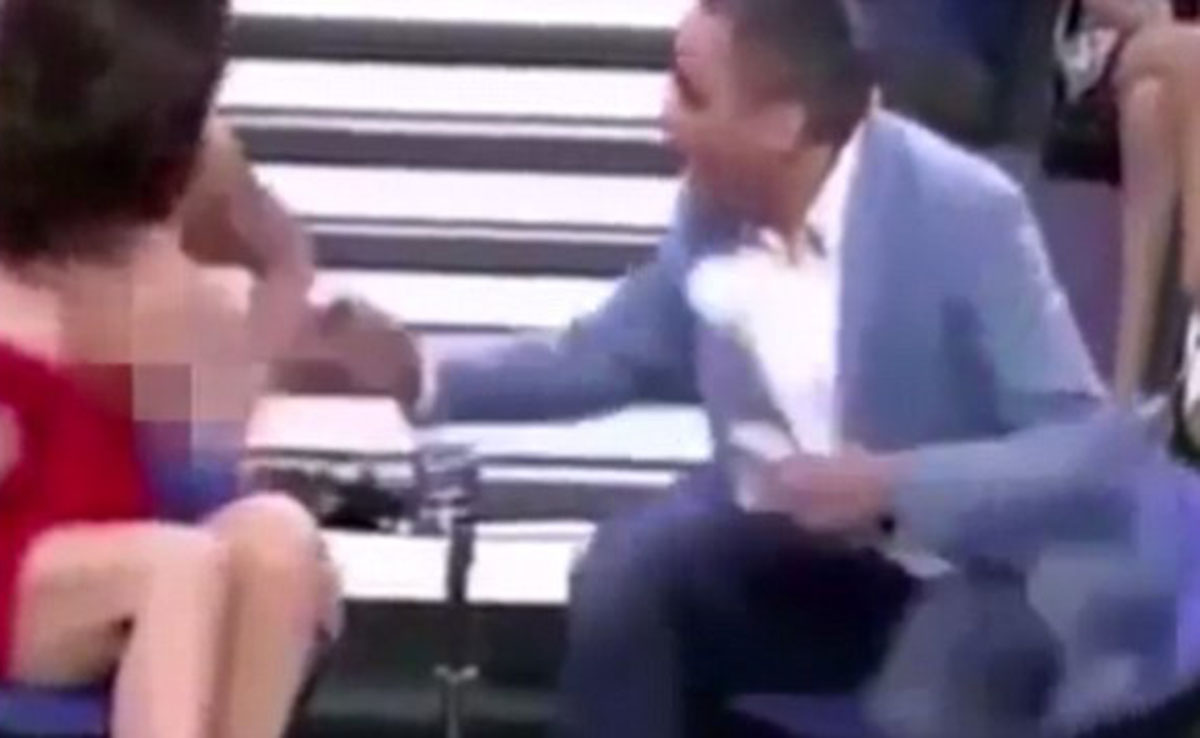 Yola Berrocal's dress gets tugged down leaving her exposed on live TV (Picture: Telecinco)