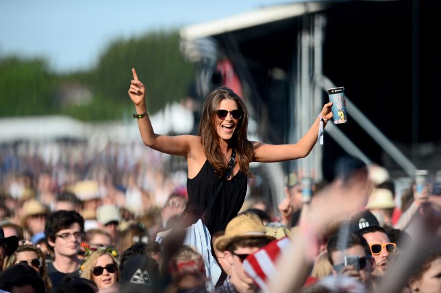 NEWPORT, ISLE OF WIGHT - JUNE 13: Festival-goers are seen during Tom Odell performance at The Isle of Wight Festival at Seaclose Park on June 13, 2014 in Newport, Isle of Wight. (Photo by Zak Hussein/Getty Images)
