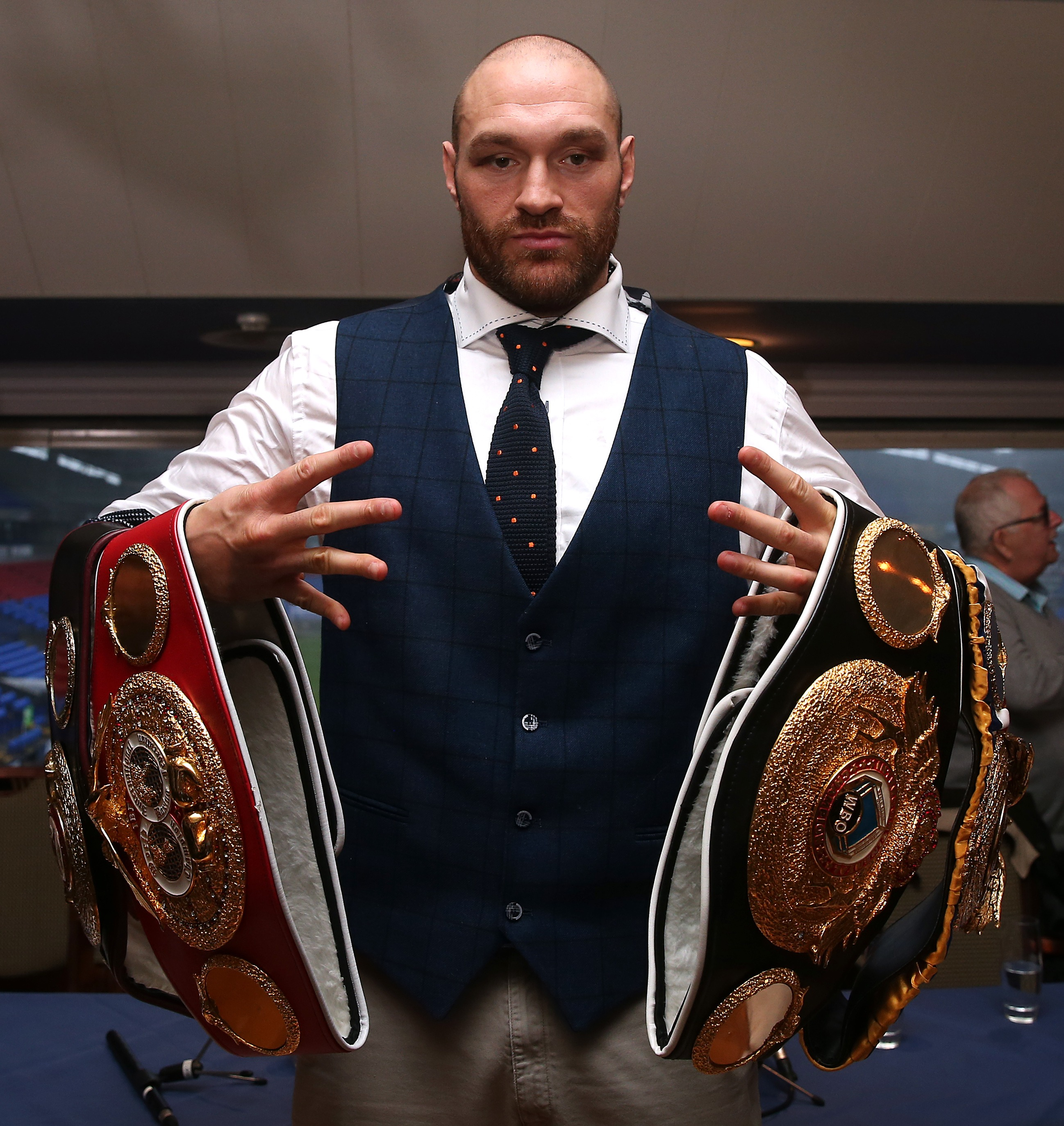BOLTON, ENGLAND - NOVEMBER 30: Tyson Fury poses with his belts following a press conference at the Macron Stadium on November 30, 2015 in Bolton, England. (Photo by Chris Brunskill/Getty Images)