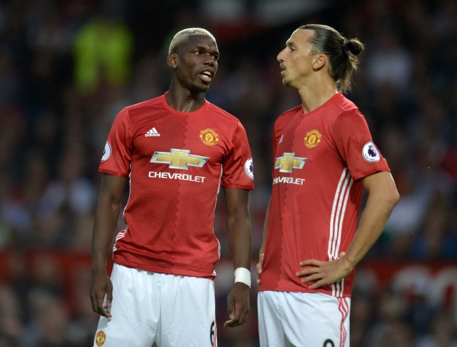 Manchester United's Swedish striker Zlatan Ibrahimovic speaks with Manchester United's French midfielder Paul Pogba (L) during the English Premier League football match between Manchester United and Southampton at Old Trafford in Manchester, north west England, on August 19, 2016. / AFP / Oli SCARFF / RESTRICTED TO EDITORIAL USE. No use with unauthorized audio, video, data, fixture lists, club/league logos or 'live' services. Online in-match use limited to 75 images, no video emulation. No use in betting, games or single club/league/player publications. / (Photo credit should read OLI SCARFF/AFP/Getty Images)