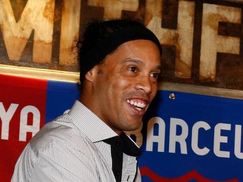 Barcelona ambassador Ronaldinho relaxes on the beach instead of attending Deportivo game