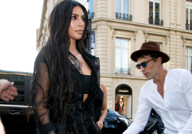 PARIS, FRANCE - SEPTEMBER 28: Vitalii Sediuk jumps on Kim Kardashian West as she arrives at 'L'Avenue' restaurant on September 28, 2016 in Paris, France. (Photo by Marc Piasecki/GC Images)