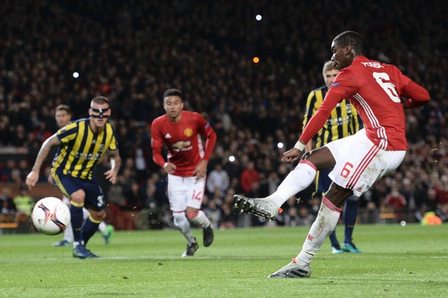 Manchester United's French midfielder Paul Pogba (R) scores their first goal from the penalty spot during the UEFA Europa League group A football match between Manchester United and Fenerbahce at Old Trafford in Manchester, north west England, on October 20, 2016. / AFP / OLI SCARFF (Photo credit should read OLI SCARFF/AFP/Getty Images)