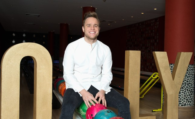 """LONDON, ENGLAND - OCTOBER 20: Olly Murs poses for photos during his new album """"24HRS"""" playback at Ham Yard Hotel on October 20, 2016 in London, England. (Photo by Dave J Hogan/Dave J Hogan/Getty Images)"""