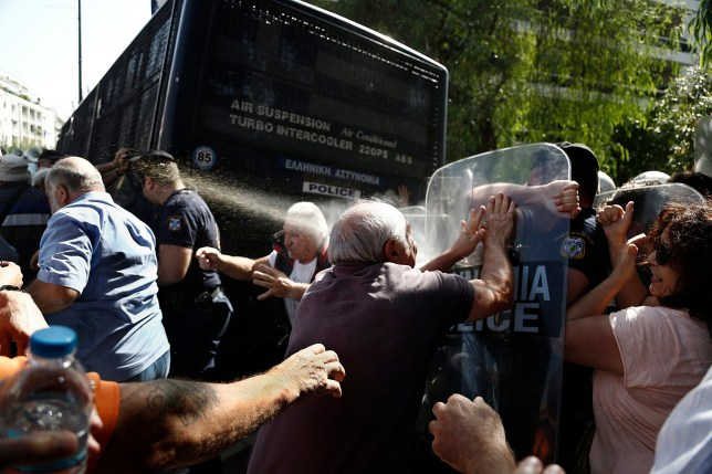epa05568091 Greek riot policemen use tear gas as they try to disperse pensioners taking part in an anti-austerity protest against planned pension cuts, near the prime minister's office in central Athens, Greece, 03 October 2016. EPA/YANNIS KOLESIDIS