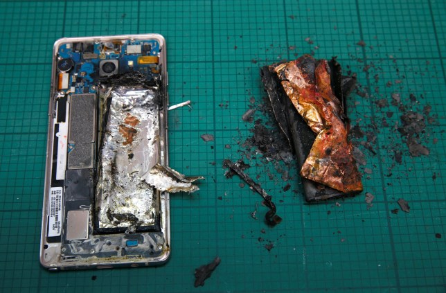 A Samsung Note 7 handset is pictured next to its charred battery after catching fire during a test at the Applied Energy Hub battery laboratory in Singapore October 5, 2016. REUTERS/Edgar Su