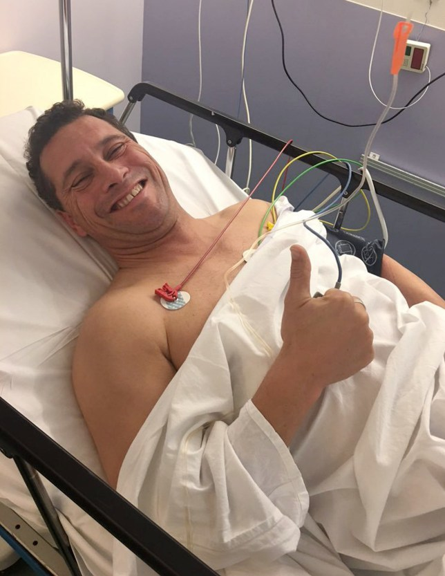 In this image made available Friday Oct. 7, 2016, released by UK Independence Party (UKIP), UKIP MEP Steven Woolfe gives a thumbs up from his hospital bed at Hospital De Hautepierr in Strasbourg, France, Friday Oct. 7 , 2016, where he is recovering following an altercation with a colleague in the European Parliament. U.K. Independence Party legislator Woolfe has been moved to the hospital's neurological unit as a precaution, after being injured Thursday. (Hermann Kelly UKIP via AP)