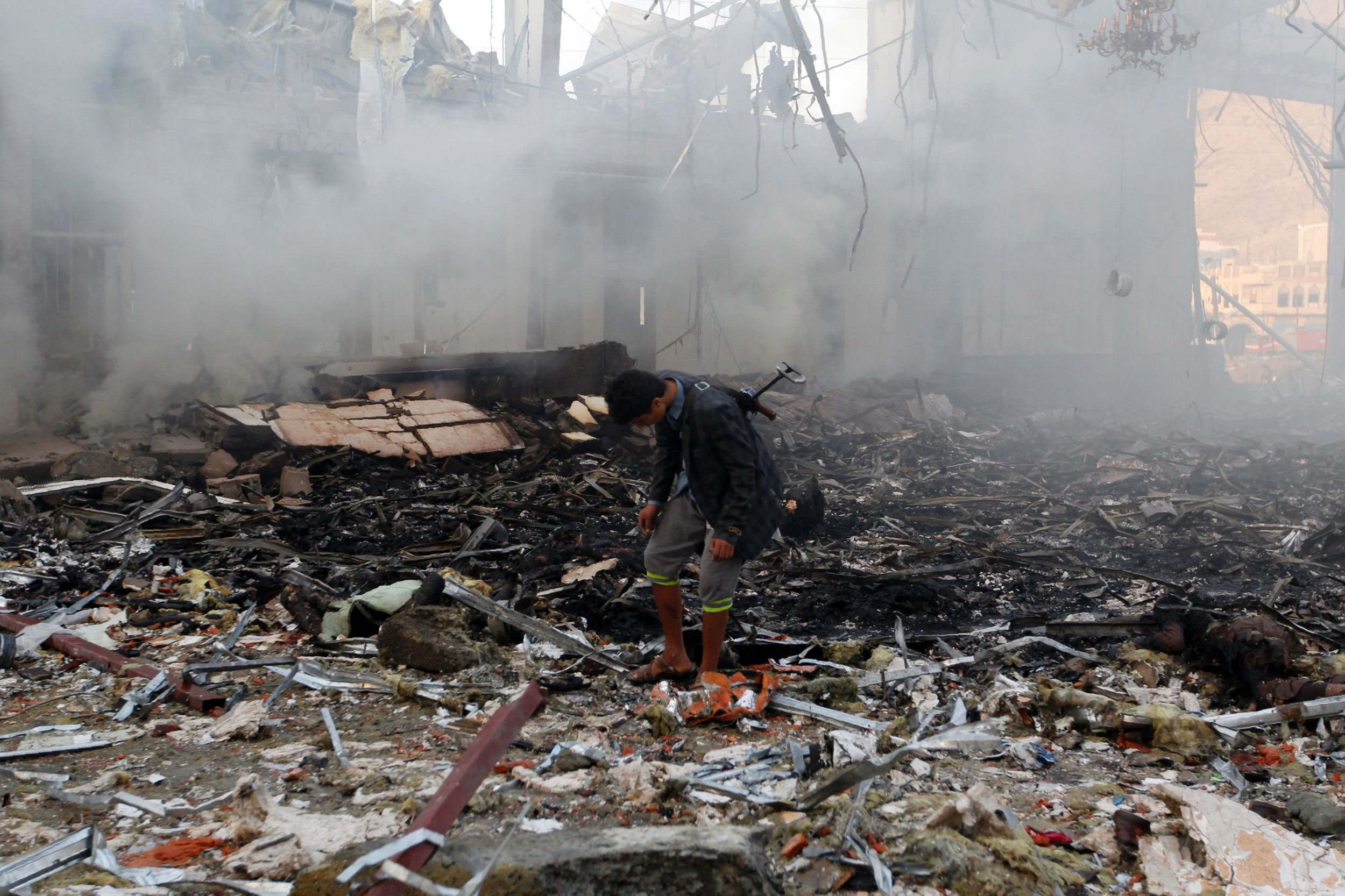 Saudi coalition admits it was behind bombing of funeral hall that killed 140