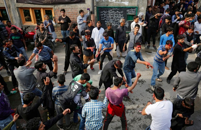 epa05577967 Kashmiri Shiite Muslims flagellate themselves as they take part in a religious procession held on the seventh day of Islamic month of Muharram, in Srinagar, the summer capital of Indian Kashmir, 09 October 2016. Muharram, the first month of the Islamic calendar, is observed around the world for 10 days of mourning in remembrance of the martyrdom of Imam Husain, the grandson of Prophet Muhammad. EPA/FAROOQ KHAN