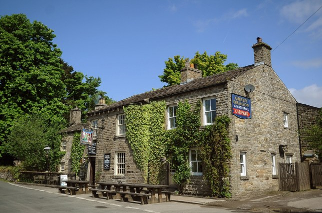 The Green Dragon Inn, at Hardraw near Hawes, North Yorkshire. A picturesque 13th century pub complete with a waterfall that Kevin Costner famously bathed naked in whilst filming a Hollywood blockbuster is up for sale. See ROSS PARRY story RPYPUB. The beautiful North Yorkshire Dales site has gone up for sale for a whopping £1.5m and includes the pub, 5.5. hectares of parkland, a visitor centre, a campsite and Hardraw Force - England's highest single drop waterfall, which was used as a location for the 1991 movie Robin Hood - Prince of Thieves. It featured in a scene when Maid Marian catches Robin Hood bathing naked in the lake at the base of the waterfall. But the pub hasn't always been as valuable and had been bought for just £375,000 in 2001. Owner Mark Thompson has spent a decade's hard work restoring the 13th century Green Dragon Inn at Hardraw near Hawes, North Yorkshire.