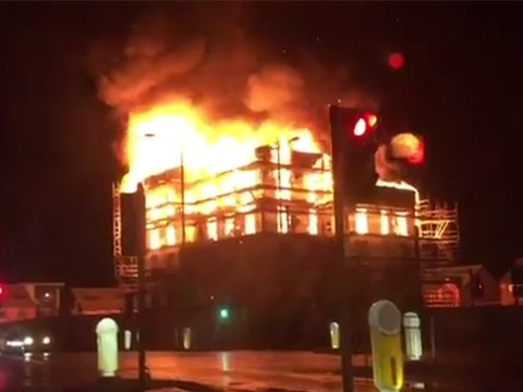 Flames seen for miles as huge fire engulfs block of flats in Manchester