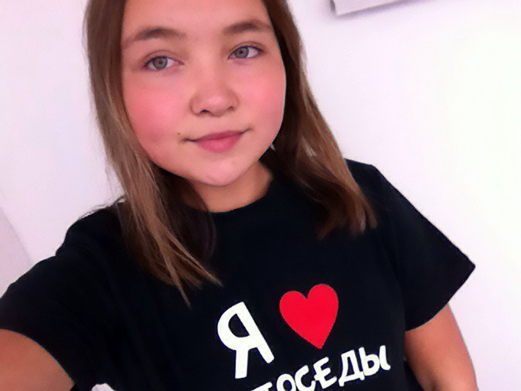 """Pic shows: The last two selfies of the girl; A schoolgirl who climbed over a ledge on the 17th¿floor of a block of flats to take a cool selfie sent a dangerous looking snap to her friend an instant before she fell to her death. The tragedy happened in the city of Perm in central Russia's Perm Krai region. Shortly before the tragedy the 12-year-old schoolgirl named as Oksana B. had even written a note to her best friend on her Vkontakte (the Russian Facebook-like social network) account telling her she how great she was and how special their friendship was. She had then wanted to apparently send a picture, and after saying goodbye to her mum and telling her she was going for a walk, instead went up to the seventeenth floor of of her block of flats, where she then took a call self posted it standing on the other side of the rooftop balcony. The friend noticed that the picture seems to be particularly dangerous had then tried to call Oksana back, and when she couldn't reach her, had sent the picture to her mum. But by then it was too late, as she had already fallen and her body had been spotted by passers-by. They in turn raise the alarm with police, and her mother had been informed. Police believe the schoolgirl lost her balance while sitting on the handrail and fell. The dead girl's uncle posted on social media: """"She was such a friendly girl. She was a good pupil, she had no problems at school. She took dance classes and English classes. She had so much to live for and now she has lost her life to the craze of looking for extreme selfies for social media. There can be no other reason why she climbed over the damned handrail."""" The police are investigating the tragedy."""