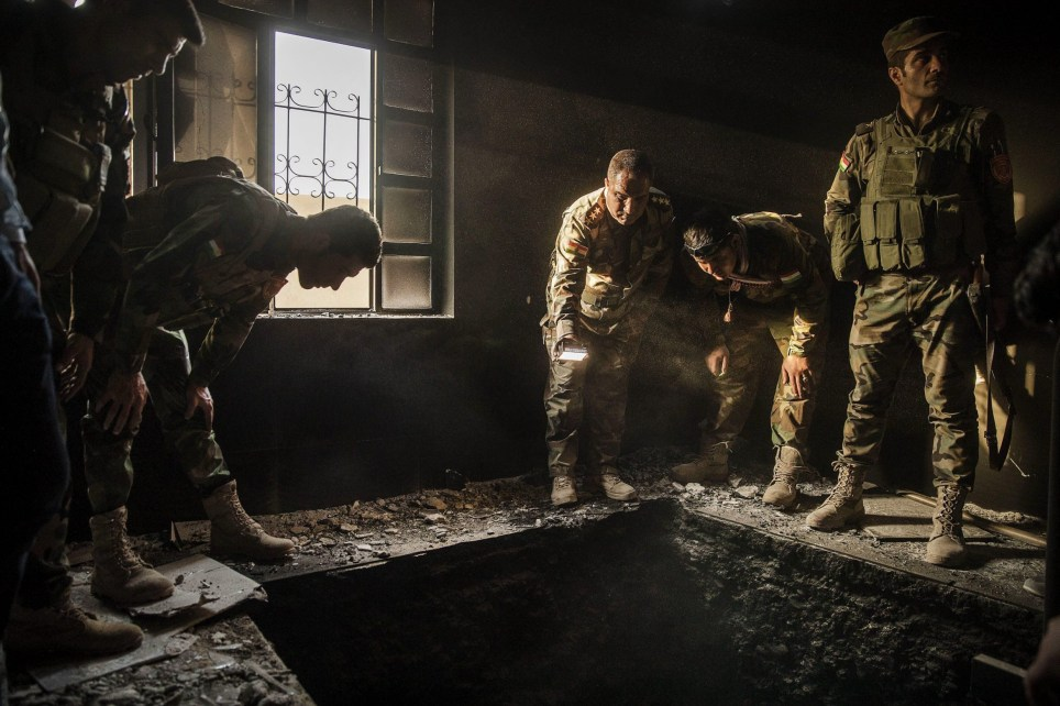 IMAGES OUTSIDE OF PRINT NEWSPAPER SUBSCRIPTION DEALS. WEB FEES - GBP 40 PER IMAGE Mandatory Credit: Photo by Magnus Wennman/IBL/REX/Shutterstock (6431687f) Kurdish Peshmerga forces inspect a tunnel inside an abandoned house in the outskirts of Mosul, Iraq, recaptured from the Islamic State (IS) jihadists by Kurdish Peshmerga and Iraqi forces. The battle of Mosul, Iraq - 18 Oct 2016