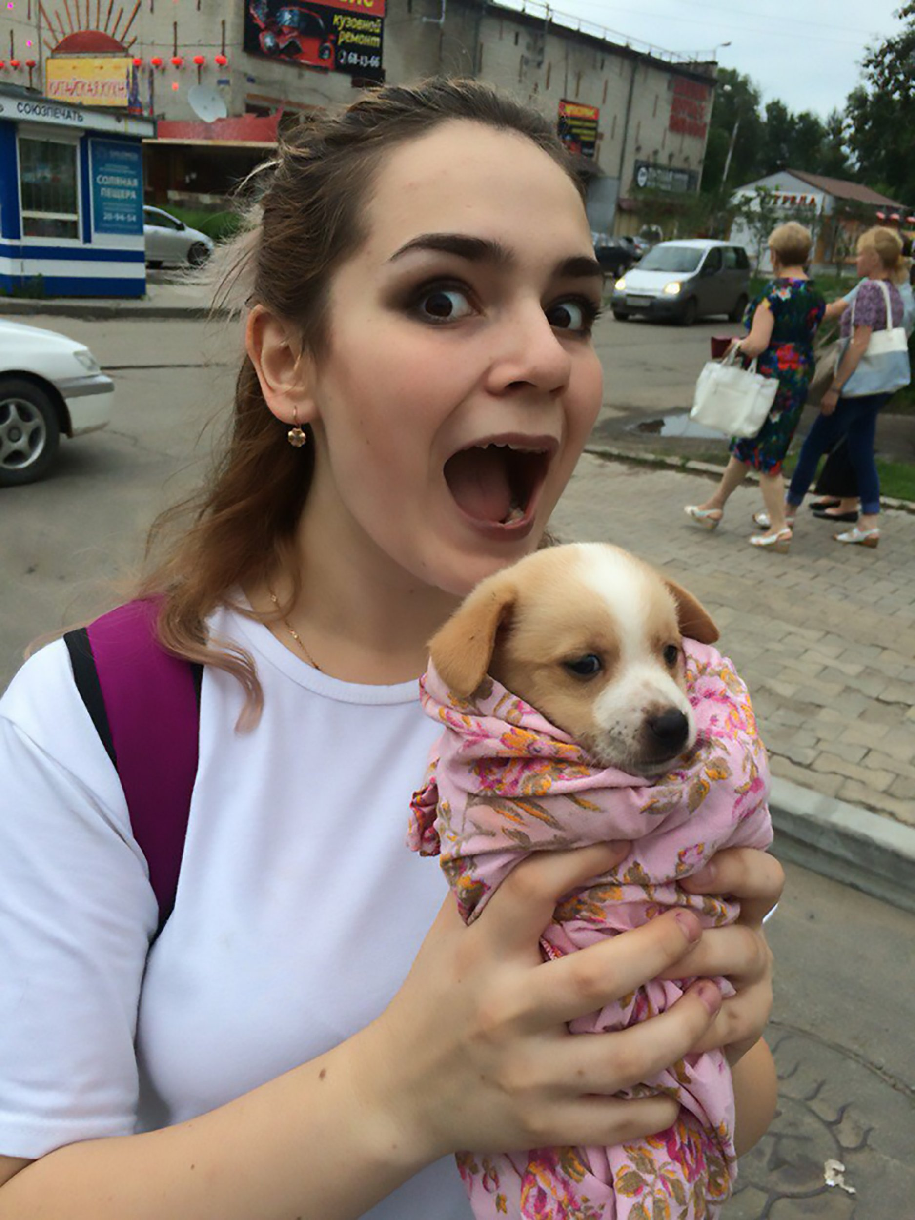 """Pic shows: Alina with a dog; A teenage girl has been arrested for torturing and killing cats and dogs with her friend and then posting the footage of their reign of terror online. Alina Orlova, 17, was arrested in the far eastern Russian city of Vladivostok where she was waiting for a connecting flight between her home city of Khabarovsk in south-eastern Russia to St Petersburg in the north-western part of the country. She and her friend, Kristina K., who likes to wear horror movie-style makeup and contact lenses, posted photographs and videos of themselves apparently torturing and killing cats and dogs for """"bloodlust"""". The horrific images show one dog nailed to a wall as if it had been crucified and another hanging by its collar and then shot with an air gun. Other animals are seen dead - including one which the girls cut open to pull out its internal organs. Police became involved after animal lovers reacted with outrage to the graphic images that were posed on social media. Local residents started a petition calling on the authorities to do something about the teenage torturers. Both of the callous girls are students and live in the city of Khabarovsk in south-eastern Russiaís Khabarovsk Krai region. They said they had been adopting unwanted animals which they had promised to look after but instead they had tortured and killed them, posting photographic evidence online. Orlova is seen clutching a cute puppy with her mouth open wide as if she is about to bite it, and another image shows Kristina menacingly holding a hammer and a nail. Netizen ëDmitriy Dmitrieví said: """"Somebody should do the same to them, in the same manner they treat these animals."""" And ëMaria Ivanoví added: """"OMG, I feel so bad after seeing it. One of the dogs that is still alive looks so adorable on the photo and is already hanging dead on the other one. """"How can their mothers defend it. I would have probably reported on my child if he did something like that. Horrible."""" Orlova also posted that s"""