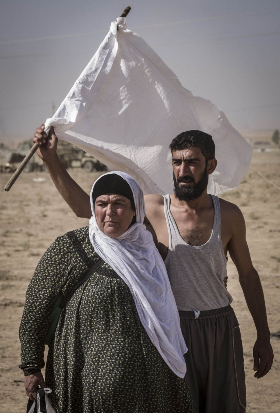 Mandatory Credit: Photo by Berci Feher/ZUMA Wire/REX/Shutterstock (6610914a) Nineveh Governorate, Iraq - Civilians are escaping from Khorsabad which is controlled by the isis and under Peshmerga fire. Battle for Mosul, Iraq - 21 Oct 2016