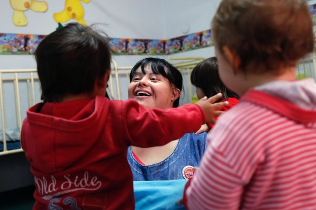 "Noelia Garella (C), a kindergarten teacher born with Down Syndrome, plays with children at the Jeromito kindergarten in Cordoba, Argentina on September 29, 2016. When Noelia Garella was a child, a nursery school rejected her as a ""monster."" Now 31, she is in a class of her own. In the face of prejudice, she is the first person with Down syndrome to work as a kindergarten teacher in Argentina -- and one of few in the world. / AFP PHOTO / DIEGO LIMADIEGO LIMA/AFP/Getty Images"
