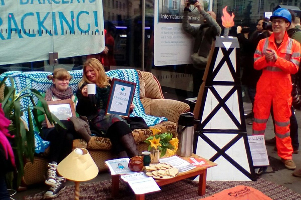 Women sip tea on sofa in the most British protest ever