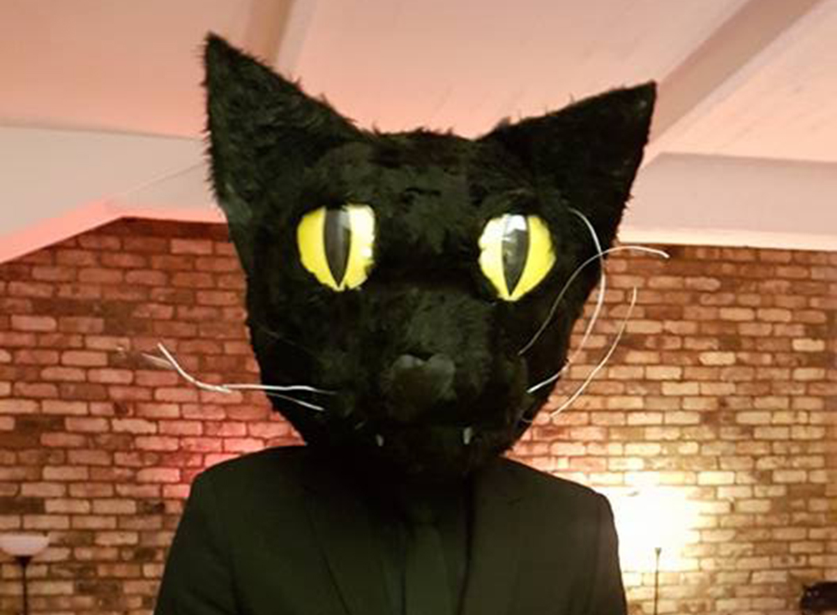 Man dresses as his cat for Halloween - his cat's expression says it all