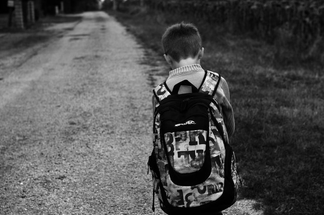 A primary school pupil is on his way to school along a road, on September 4, 2012, in Varennes, southwestern France, before the start of the new school year. AFP PHOTO / REMY GABALDA        (Photo credit should read REMY GABALDA/AFP/GettyImages)
