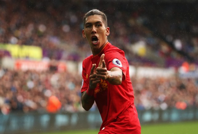 SWANSEA, WALES - OCTOBER 01: Roberto Firmino of Liverpool  celebrates scoring his sides first goal during the Premier League match between Swansea City and Liverpool at Liberty Stadium on October 1, 2016 in Swansea, Wales.  (Photo by Julian Finney/Getty Images)
