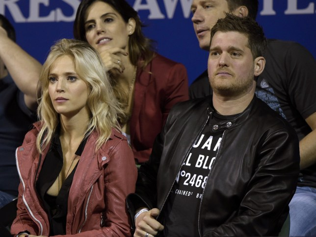 Argentine actress Luisana Lopilato (L) and her housband Canadian singer Michael Buble attend the ATP Argentina Open tennis match between Spanish tennis player Rafel Nadal and Argentine tennis player Federico Delbonis in Buenos Aires on February 27, 2015. Nadal won 6-1, 6-1. AFP PHOTO / JUAN MABROMATA (Photo credit should read JUAN MABROMATA/AFP/Getty Images)