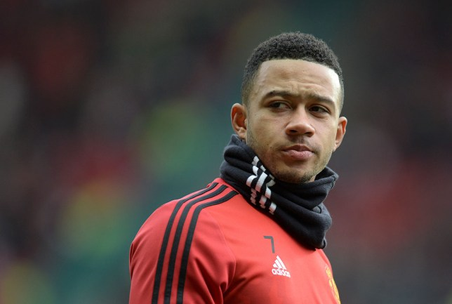 Manchester United's Dutch midfielder Memphis Depay warms up before the English Premier League football match between Manchester United and Southampton at Old Trafford in Manchester, north west England, on January 23, 2016. AFP PHOTO / OLI SCARFF / AFP / OLI SCARFF (Photo credit should read OLI SCARFF/AFP/Getty Images)