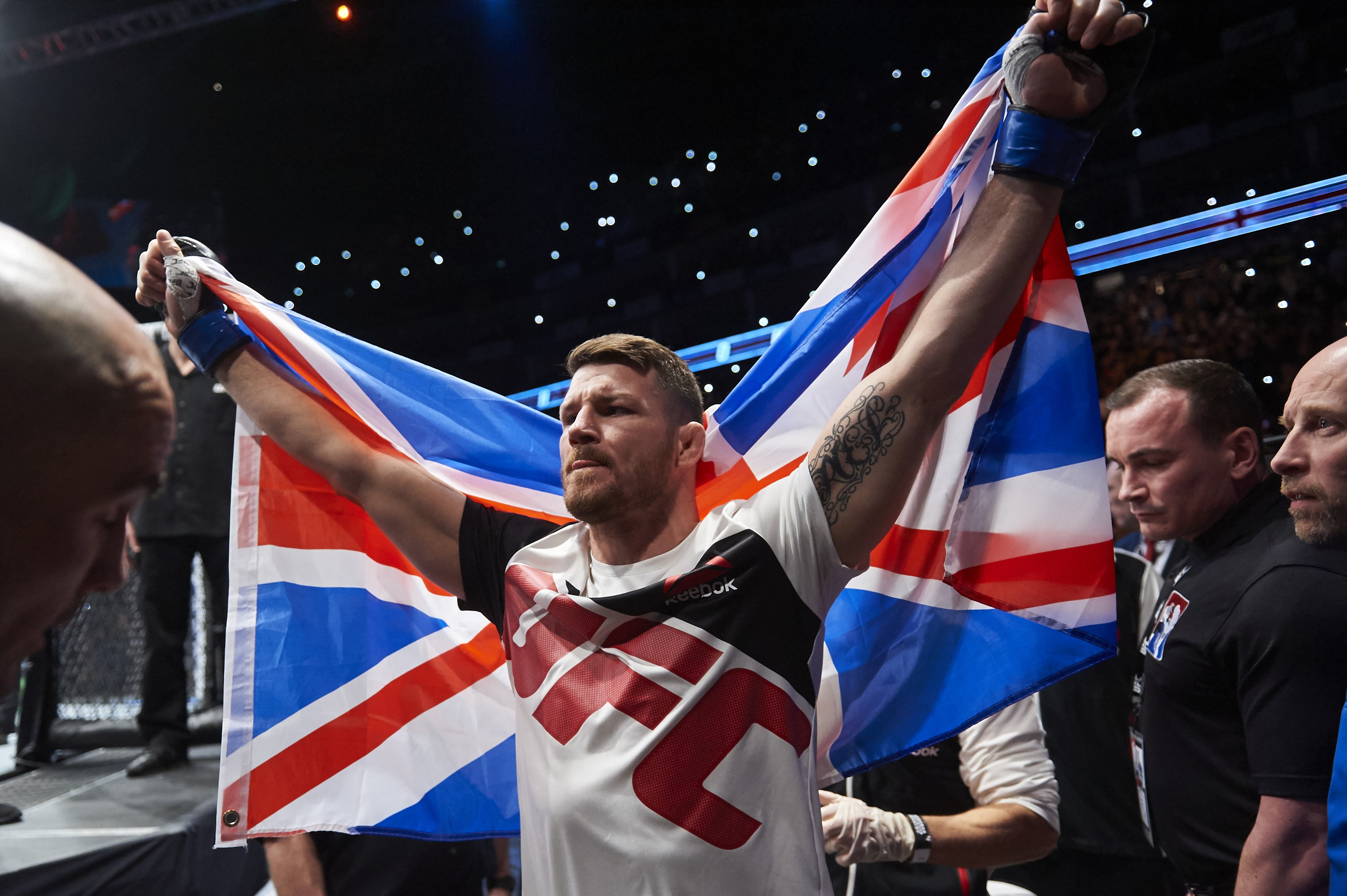 British fighter Michael Bisping walks to the ring for his fight with Anderson Silva of Brazil (not pictured) in their middleweight bout at the Ultimate Fighting Championship (UFC) Fight Night event in London on February 27, 2016. Bisping beat Silva on a judge's decision over five rounds. / AFP / NIKLAS HALLE'N (Photo credit should read NIKLAS HALLE'N/AFP/Getty Images)