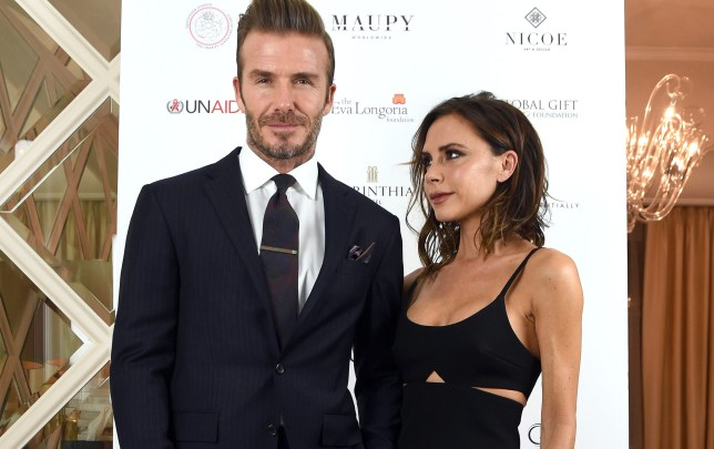 Victoria Beckham has been photographed gazing at husband David on the Global Gift Gala red carpet (Picture: Karwai Tang/WireImage/Getty Images)
