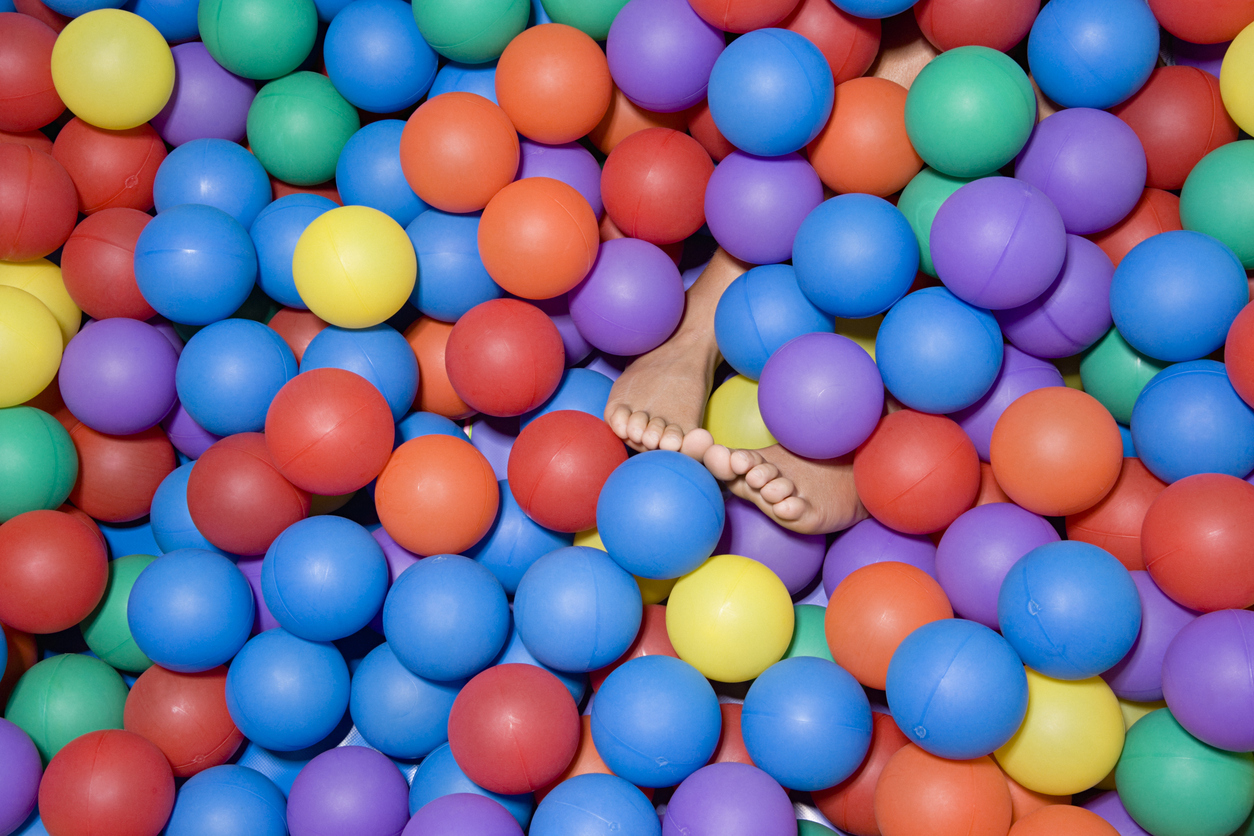 Feet in a ball pool