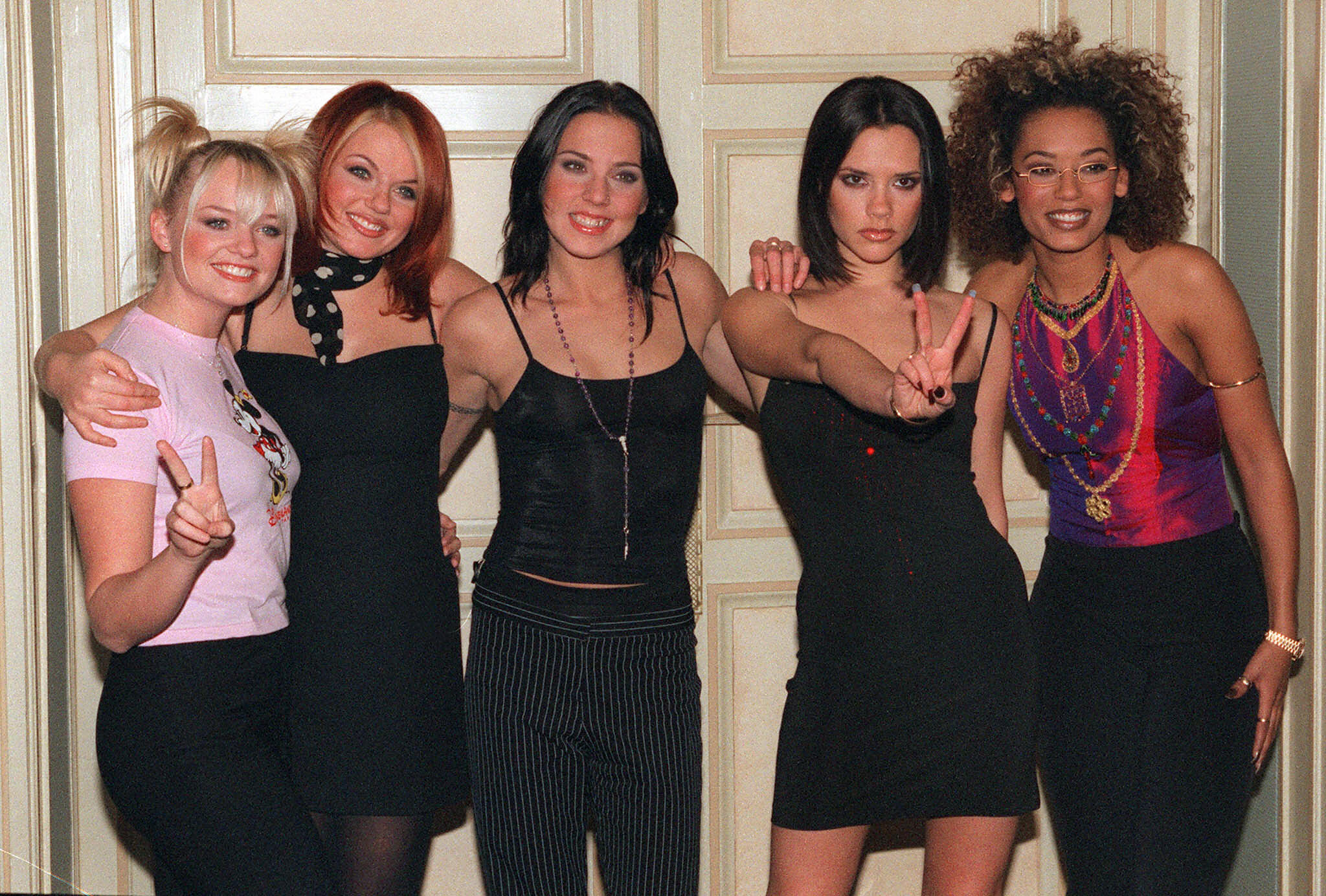Melanie Chisholm (middle) says the 'insane' levels of fame that followed the popularity of the Spice Girls led to her developing an eating disorder (Picture: AFP/Getty Images)