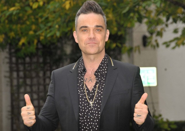 Picture Shows: Robbie Williams October 28, 2016 Robbie Williams attends a press conference at the Intercontinental Hotel in Dublin, Ireland. He announced that he will be playing at the Aviva Stadium next year as part of his 'Heavy Entertainment Show Tour'. Non Exclusive WORLDWIDE RIGHTS - NO IRELAND Pictures by : FameFlynet UK © 2016 Tel : +44 (0)20 3551 5049 Email : info@fameflynet.uk.com
