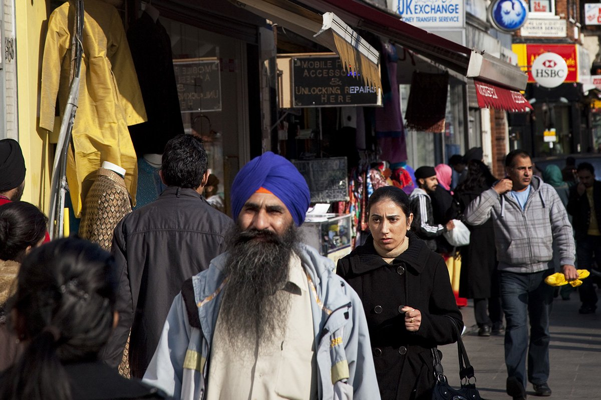 UK cities are being ripped apart by racial dvide Southall in West London, also known as 'Little India' by some, is an area almost completely populated by people from South Asia. Figures show that the area is approximately 50 percent Indian in origin although walking the streets it would appear far higher as the local people go about their shopping in the many shops specialising in goods specific to this culture. The mix of religions is mainly Sikh, Hindu and Muslim. Southall is primarily a South Asian residential district. 1950 was when the first group of South Asians arrived in Southall, reputedly recruited to work in a local factory owned by a former British Indian Army officer. This South Asian population grew due to the closeness of expanding employment opportunities. The most significant cultural group to settle in Southall are Indian Punjabis. (Photo by In Pictures Ltd./Corbis via Getty Images)