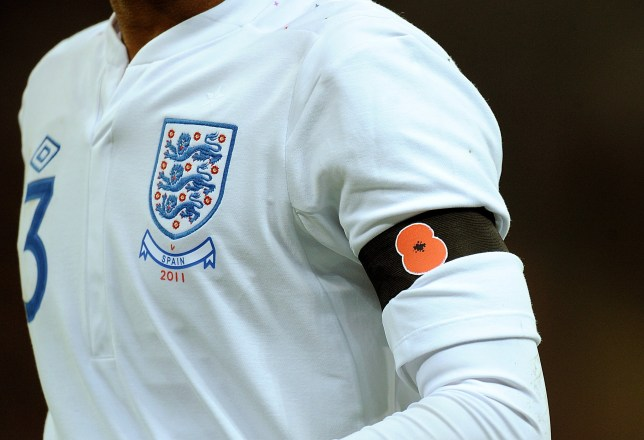 """FILE PHOTO: Fifa's ban on English and Scottish footballers wearing poppies is """"utterly outrageous"""", Prime Minister Theresa May has said. A poppy on the black armband of an England player during the match ... Soccer - International Friendly - England v Spain - Wembley Stadium ... 12-11-2011 ... London ... United Kingdom ... Photo credit should read: Tony Marshall/EMPICS Sport. Unique Reference No. 12073587 ..."""
