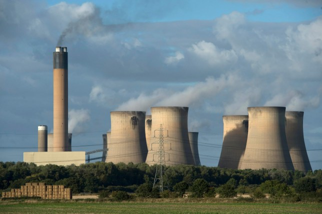 (FILES) This file photo taken on September 25, 2015 shows a view of the cooling towers of the Drax coal-fired power station near Selby, northern England. The twenty-second session of the Conference of the Parties (COP 22), the annual round of UN climate talks, will be held in Marrakech, from November 7 until November 18, 2016. / AFP PHOTO / OLI SCARFFOLI SCARFF/AFP/Getty Images