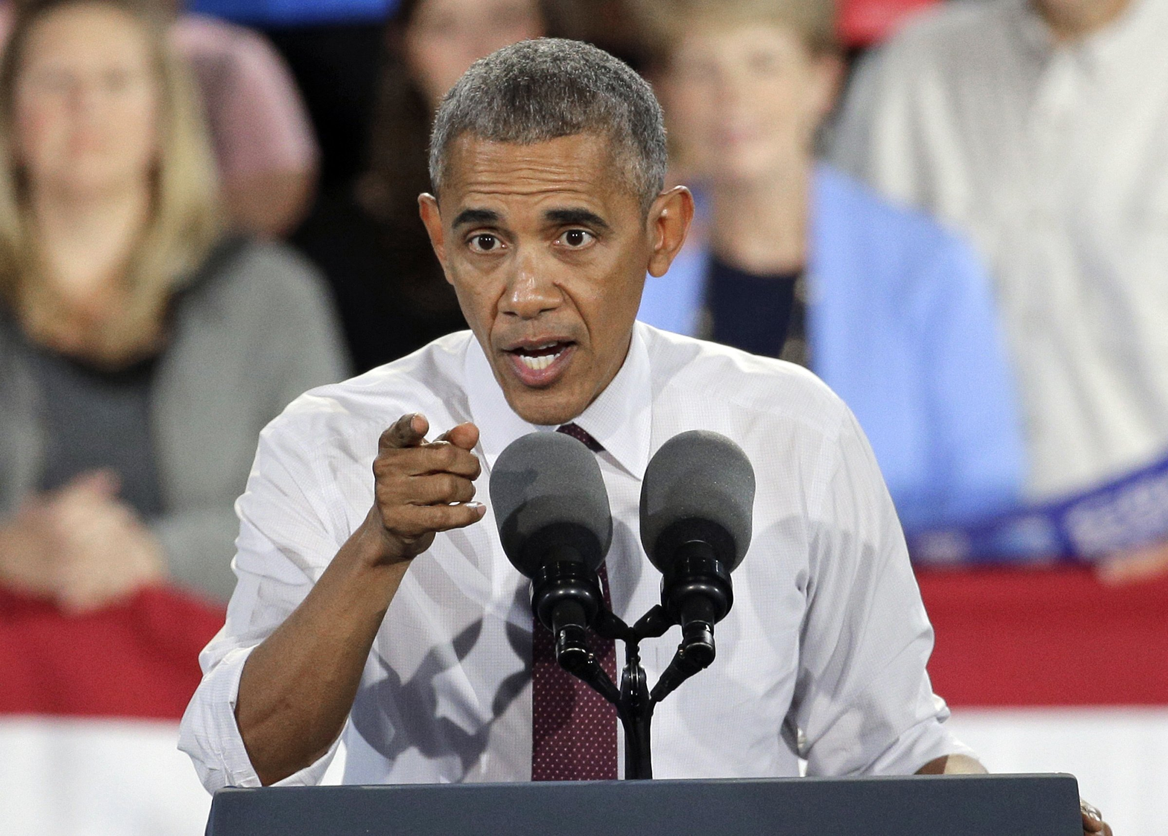 Barack Obama told off a Clinton rally for booing an elderly Trump-supporting veteran